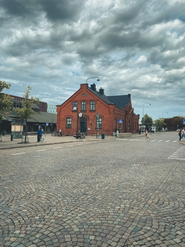 Lund, Sweden, Central Station, house, sky, cobblestone street